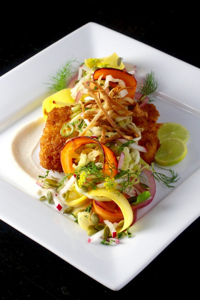 An Ode To The Fish Taco - Panko Crusted Halibut, Cabbage, Fennel, Carrot Slaw, Fresh herbs, Baja White Sauce, Tortilla Strips