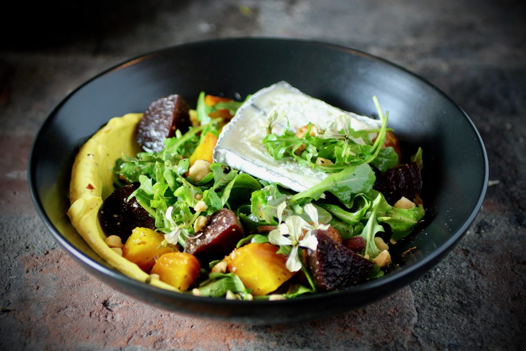 Roasted Red and Golden Beets, Humboldt Fog Goat Cheese, Hazelnuts, Turmeric-Black Pepper-Maple Yogurt, Arugula, Arugula Flowers, Beet Vinaigrette