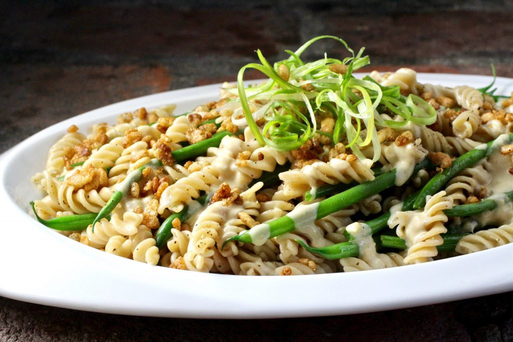 Brown Rice Fusilli and Green Beans Side Dish, Lemon Garlic Tahini Sauce, Crispy Rice Topping